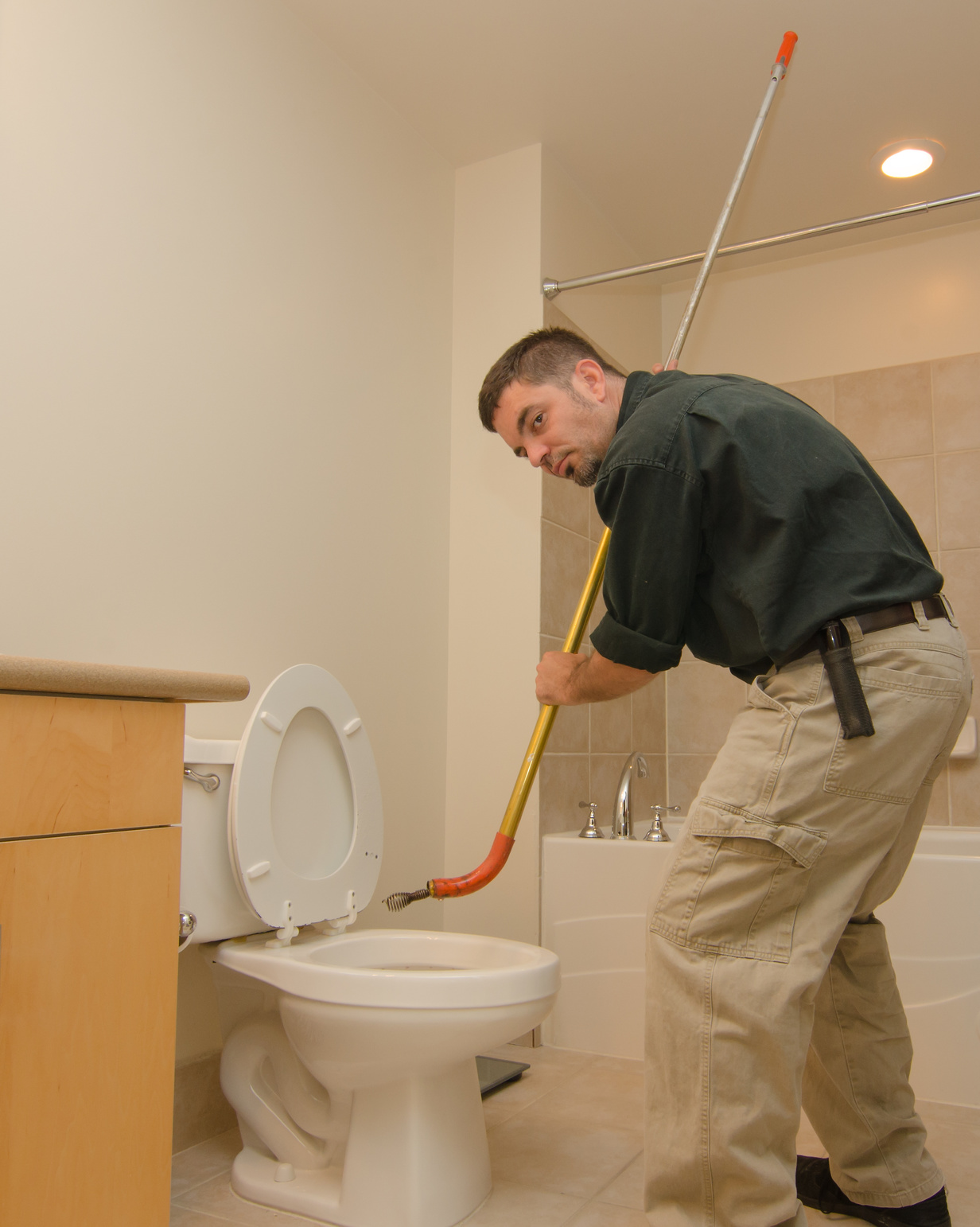 Plumber with auger